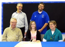 Rebecca Faber signs her letter of intent to play tennis next season for the Bluejays