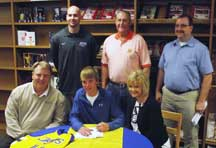 Nick Rice signs his letter of intent to play basketball at Tabor